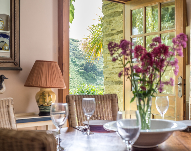 View across the valley from the dining room table of Valencia House, a self-catering holiday house in Port Isaac, Cornwall