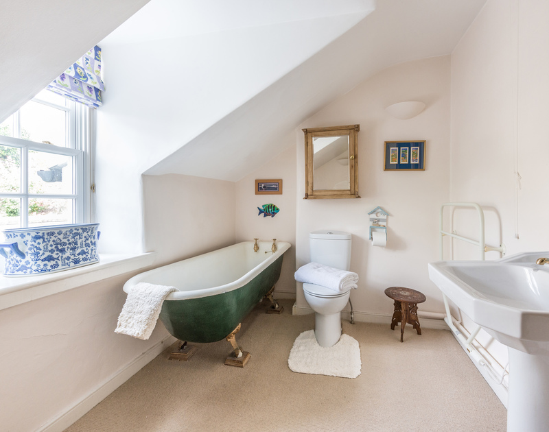 Family bathroom with claw foot iron bath at Valencia House, a holiday house in Port Isaac, Cornwall