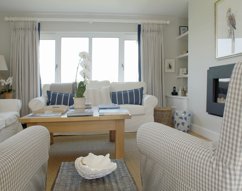The sitting room at Greenaway Heights, Cornwall is light and bright with contemporary touches and neutral tones.