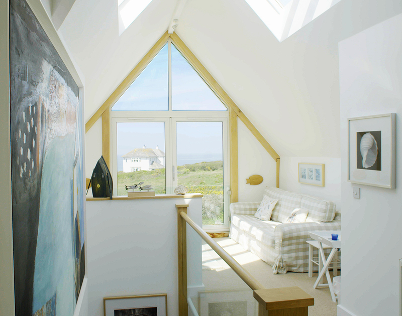 Enjoy sensational sea views and sunsets from the stylish architectural sitting area on the first floor at Greenaway Heights, North Cornwall.