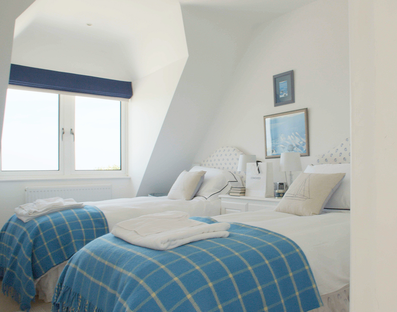 One of two sundrenched twin bedrooms at Greenaway heights, both have glorious sea views and an adjacent bathroom