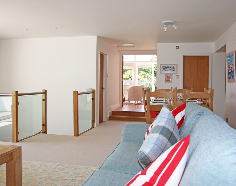 The spacious first floor leading to the sunroom at Drifters, a luxury holiday rental on the Camel Estuary in Rock, North Cornwall.