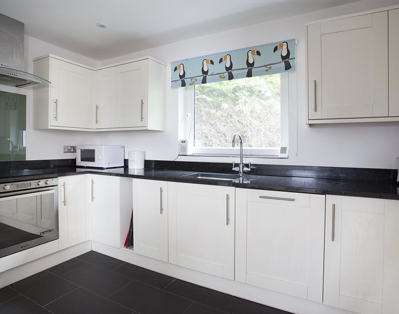 The sleek, contemporary kitchen in Drifters, a self catering, luxury holiday house in Rock, North Cornwall.