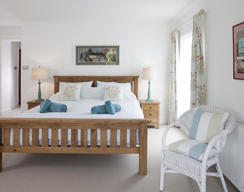 The master bedroom in Drifters, a luxury, self catering holiday house to rent in Rock, North Cornwall.