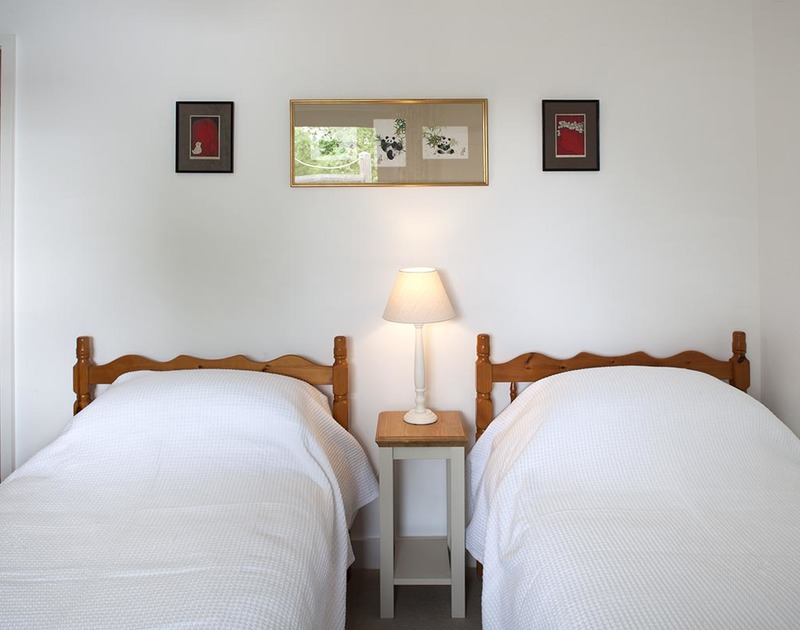 A twin bedroom at Drifters , a luxury holiday house to rent in Rock, North Cornwall.
