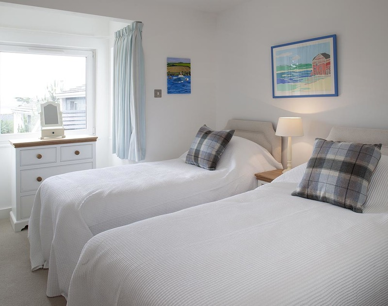 The light-filled twin bedroom on the first floor at Drifters, a luxury holiday house on the Camel Estuary in Rock, Cornwall.