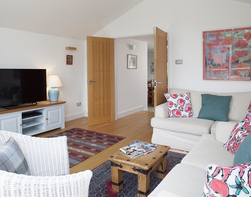 The beautifully furnished tv room in Drifters, a luxury self catering holiday house to rent in Rock, Cornwall.