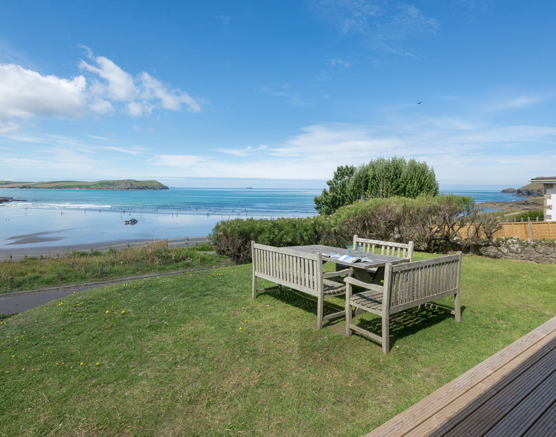Panoramic sea views from the garden of Low Cliff Cottage, a self-catering holiday house in Polzeath, Cornwall