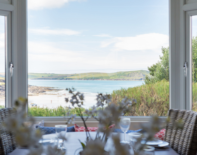 The Camel Estuary as viewed from the dining room of Low Cliff Cottage, a holiday rental in Polzeath.