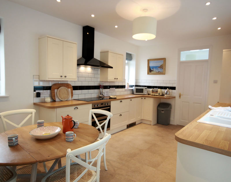 A photo of the kitchen breakfast room of Low Cliff Cottage, a seaside holiday cottage in Polzeath, Cornwall