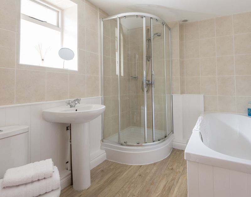 Bathroom and shower in the self catering holiday house 22, Church Hill on the North Coast of Cornwall.