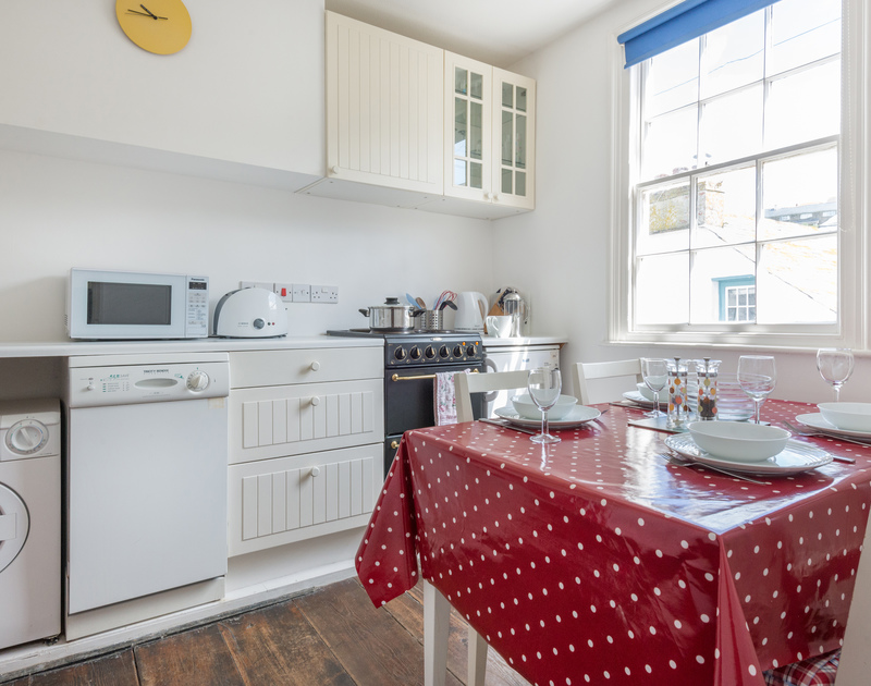 Small but well equipped kitchen with seating for 4 people and a view of the village.