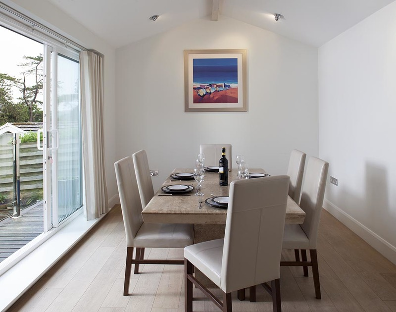 The modern open plan dining room leads off from the living room at Lyonnesse a self catering holiday home in Rock, Cornwall