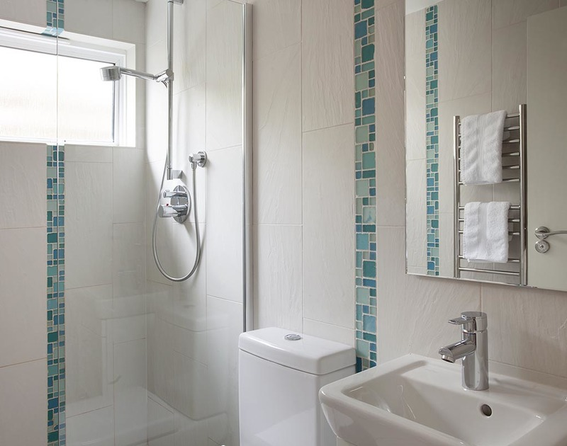 The master bedroom at Lyonesse in Cornwall has an ensuite shower room.