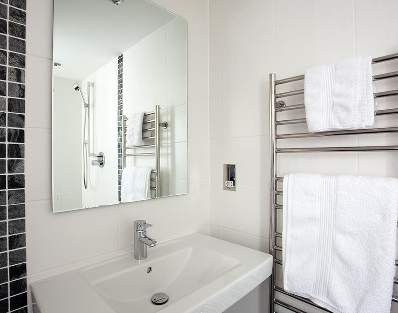 The third bathroom at Lyonesse is a wet room with shower located adjacent to the utility room