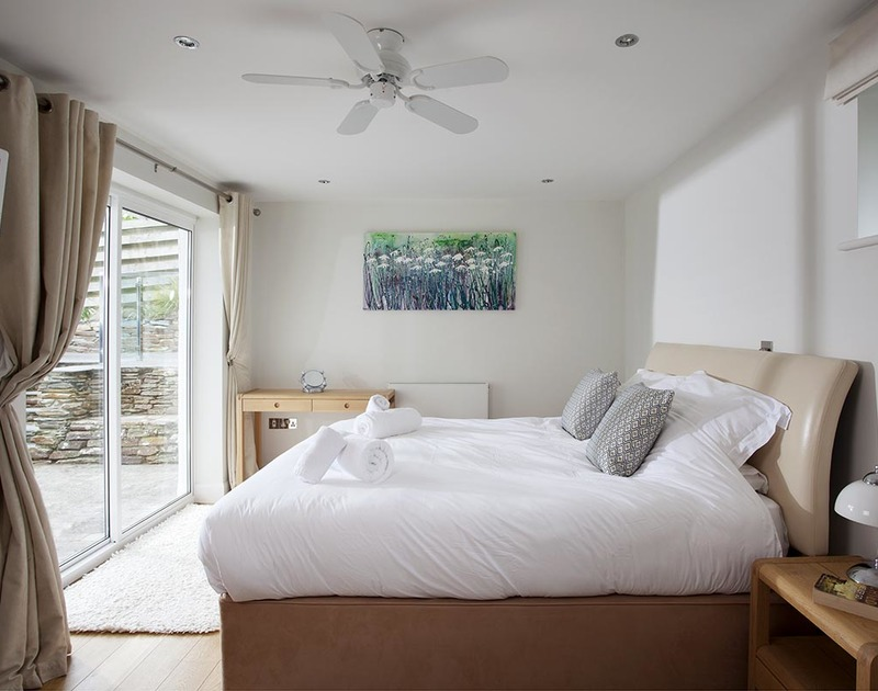 The superking master bedroom at Lyonesse in Rock has an ensuite and doors onto the sunny south facing terrace