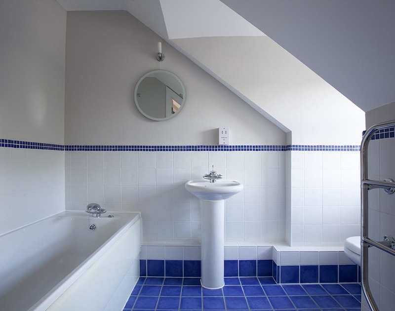 Attractive second floor ensuite bathroom at Lowenna Manor 4, with bath and WC in Rock, Cornwall