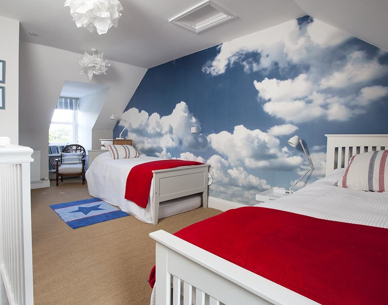 The brightly decorated, second floor twin bedroom with sky wallpaper at Lowenna Manor 4, Rock, Cornwall