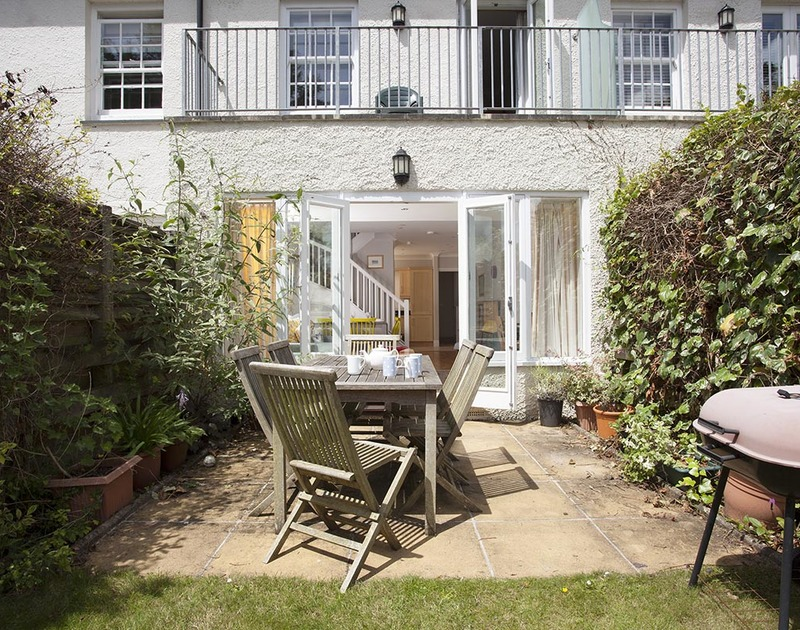 The private garden and terrace at Lowenna Manor 4, holiday house to rent in Rock is perfect for a spot of alfresco dining.