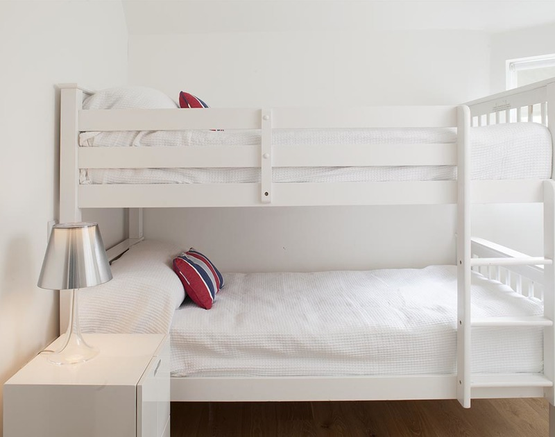 Children will love the first floor bunk room at The Beach Hut in Polzeath, North Cornwall.