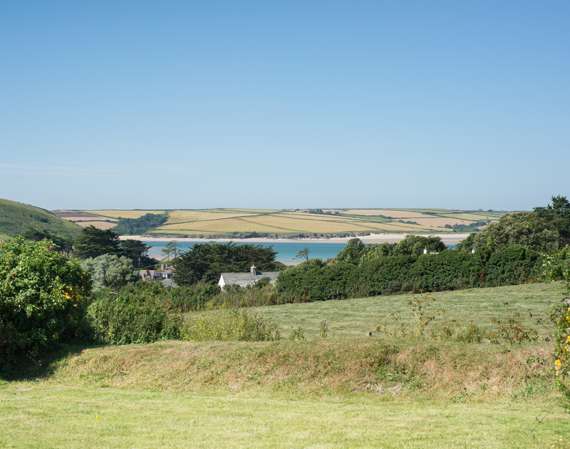 Enjoy stunning views of Brea Hill at Daymer Bay on the Camel Estuary from the principal rooms at Tide Race, a self catering holiday house.