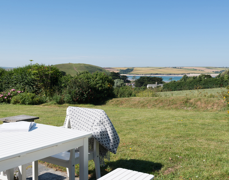The garden patio at Tide Race offers breathtaking views of Brea Hill at Daymer Bay on the North Cornwall coast.