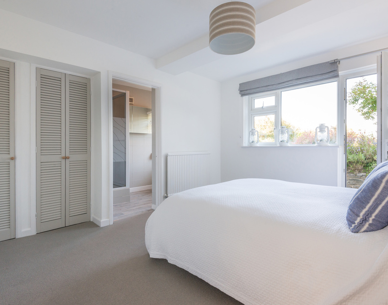 The master double bedroom suite at Tide Race in Daymer Bay has an ensuite shower room and patio door to the garden.