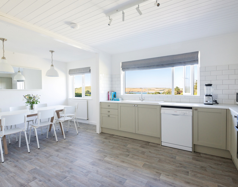 The open plan kitchen diner at Tide Race in Daymer Bay is light and spacious and offers fantastic sea views towards Daymer Bay and the Camel Estuary.