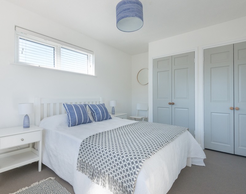 The light and calm double bedroom at Tide Race, a holiday home in Daymer Bay are inspired by the Cornish coast.
