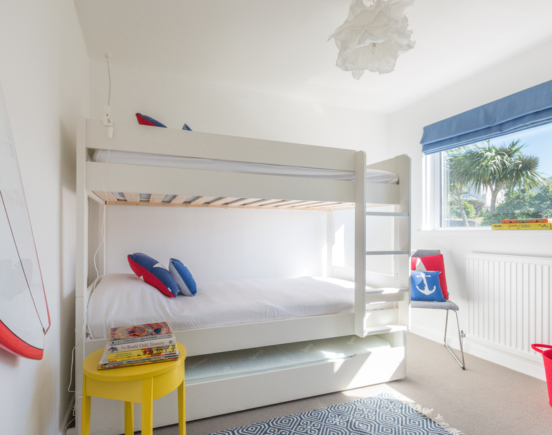 Kids will enjoy the bright surf inspired bunk bedroom at Tide Race in Daymer Bay, Cornwall