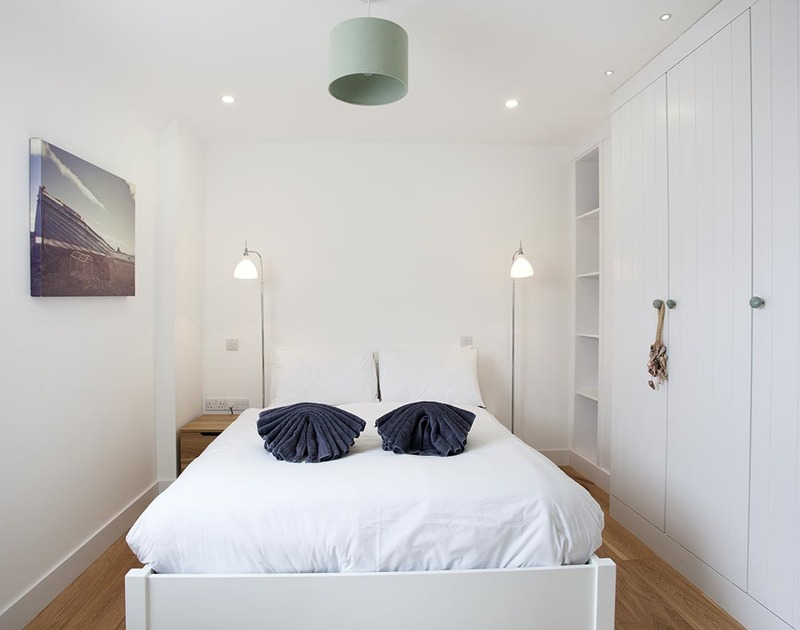 The elegant double bedroom with en-suite in Carnweather, a self catering holiday house to rent in Polzeath, Cornwall.