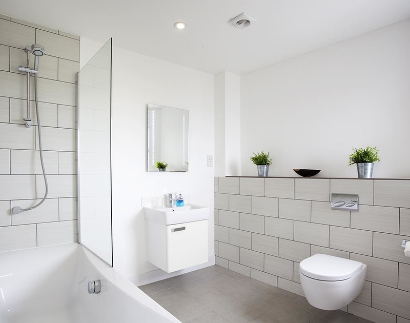 The spacious, modern bathroom in Carnweather, a self catering holiday house to rent in Polzeath, North Cornwall.