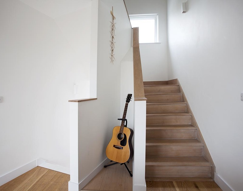 staircase at Carnweather, a contemporary self catering holiday home in Polzeath, Cornwall.