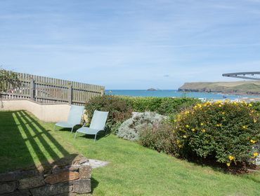 A sheltered sea-facing garden with fantastic views across the beach and out to sea.