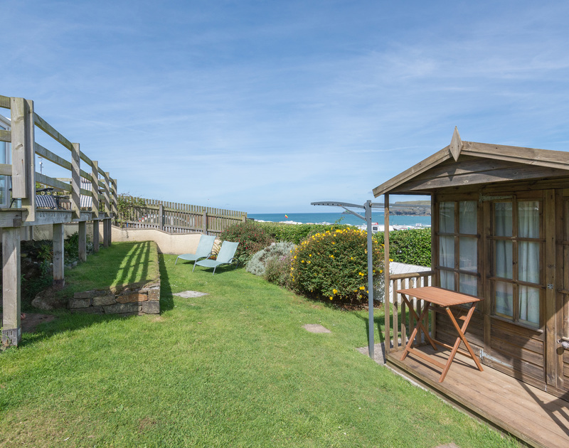 A lovely lawned garden with a sun deck and fantastic sea views.