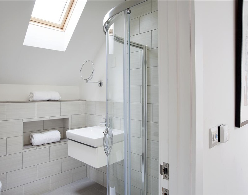 The second floor double bedroom at Kellan in Polzeath has a modern ensuite shower room.