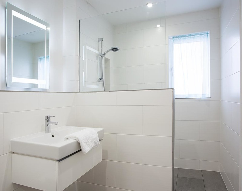 The ground floor shower room at Kellan in Polzeath is a walk in wet room, ideal for washing off the sand after a day on the beach.