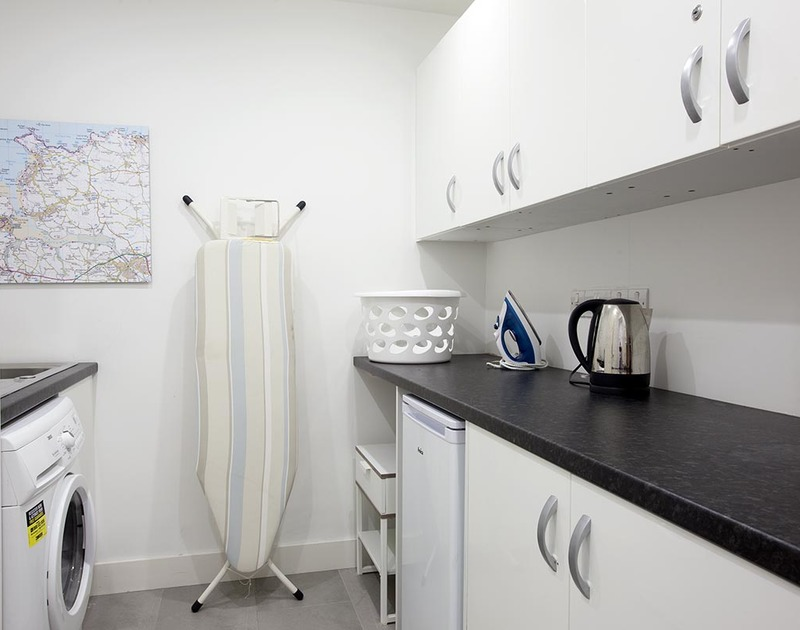 The practical ground floor utility room at Kellan, a holiday rental in Polzeath, Cornwall
