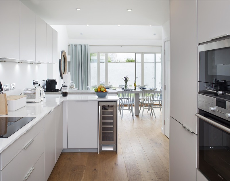 The sleek, stylish kitchen at 5, The Sands, a luxurious self catering holiday house to rent in Polzeath, North Cornwall.