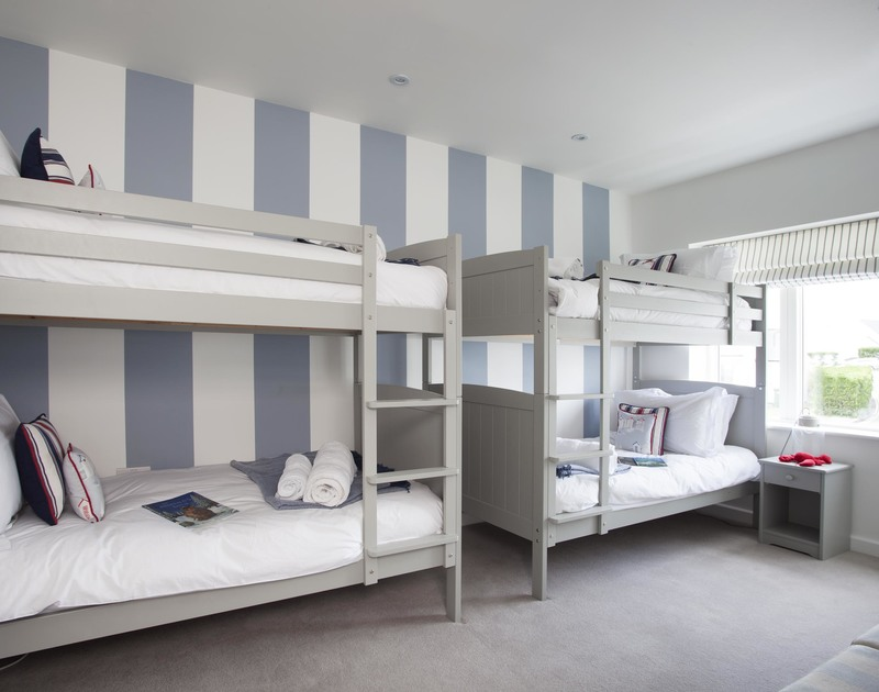 Children will enjoy staying in this stylish bunk bedroom with a cool nautical feel in 5, The Sands, a self catering holiday house to rent in Polzeath, Cornwall.