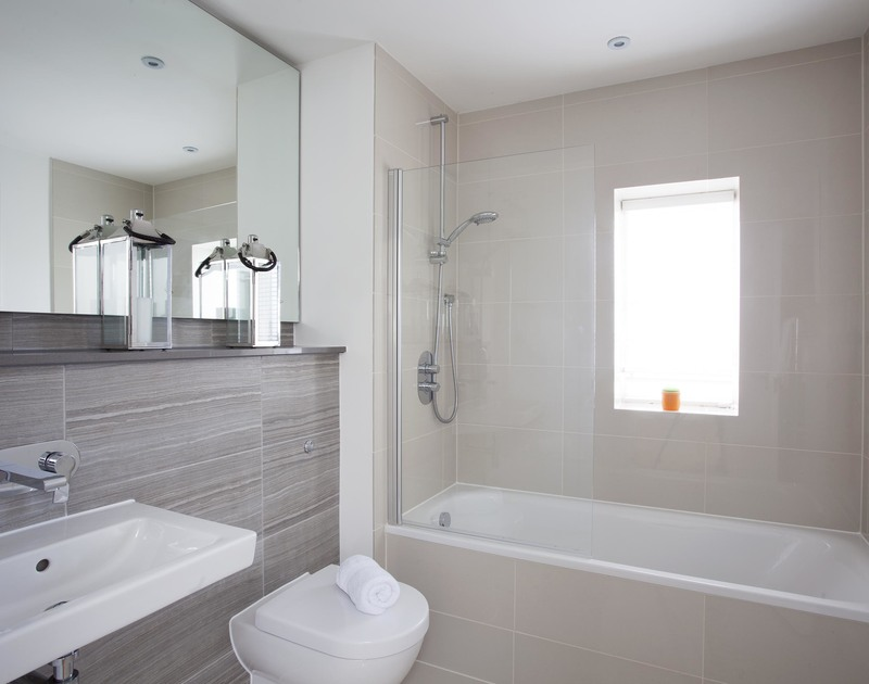 The master ensuite bathroom, one of three contemporary bathrooms at 5, The Sands, a luxury self catering holiday home to rent in Polzeath, Cornwall.