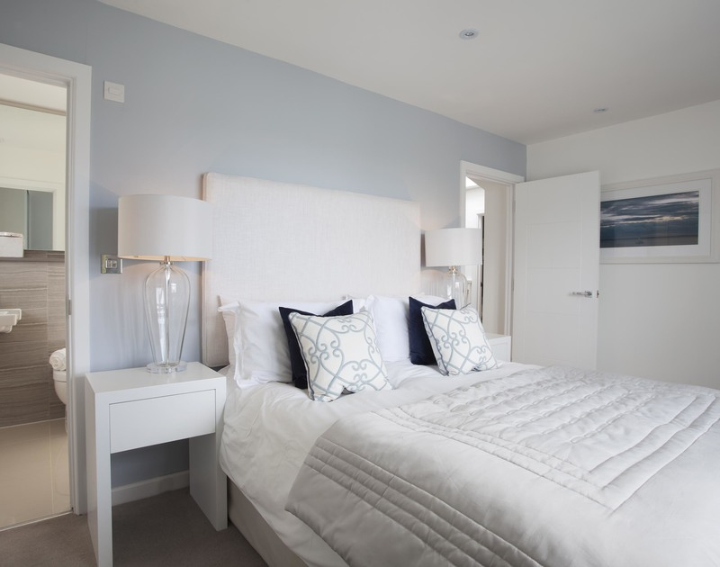 The stylish minimalist master bedroom with ensuite bathroom at 5, The Sands, a luxury self catering holiday house in Polzeath, Cornwall.