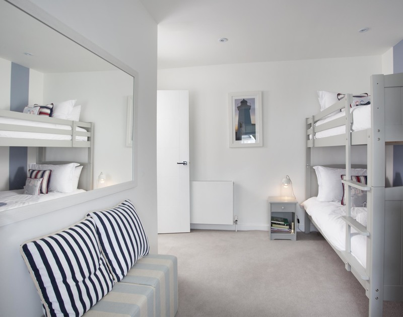 Kids will love bunking in together in the double bunk beds at 5 The Sands, a contemporary holiday home to rent in Polzeath