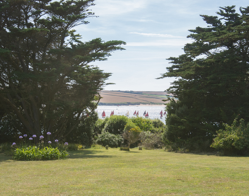 A glimpse of the Camel Estuary from the large, pretty gardens of Doom Bar House, a holiday rental at Daymer Bay, Cornwall