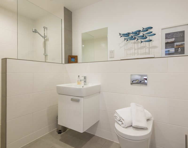 Smart downstairs bathroom with shower at Rainer Rocks a self catering holiday house to rent in Polzeath.
