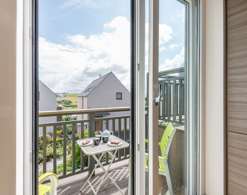 Enjoy morning tea or evening drinks on the balcony at Rainer Rocks in Polzeath.