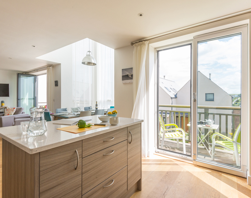 Relax and feel at ease in the fresh and light coastal inspired open plan kitchen, dining and living room space at Rainer Rocks, Polzeath.