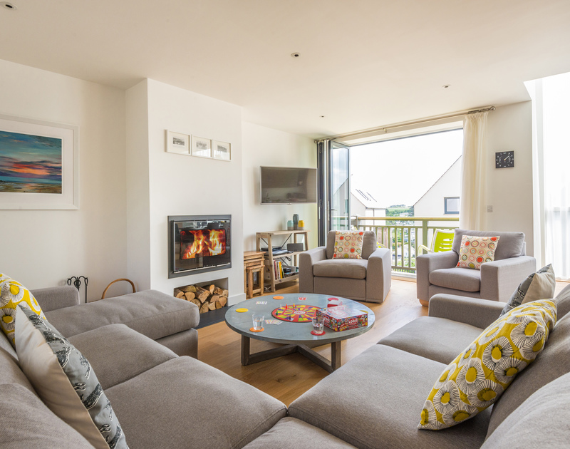 Relax in style in the bright and fresh living room at Rainer Rocks. The wood burner offers year round accommodation close to the coast and Polzeath beach.