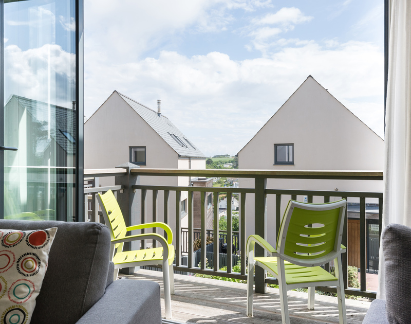 More balcony space out of the sliding glass doors off the living room at Rainer Rocks, a luxury holiday house close to the sea and beach at Polzeath in North Cornwall.
