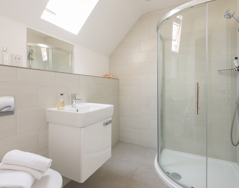 The modern bathroom with shower and skylight at Rainer Rocks in Polzeath, North Cornwall.